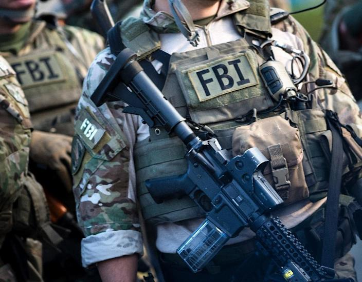 Members of a Federal Bureau of Investigation SWAT team take part in a field training exercise in Alexandria, Virginia (AFP Photo/Brendan Smialowski)