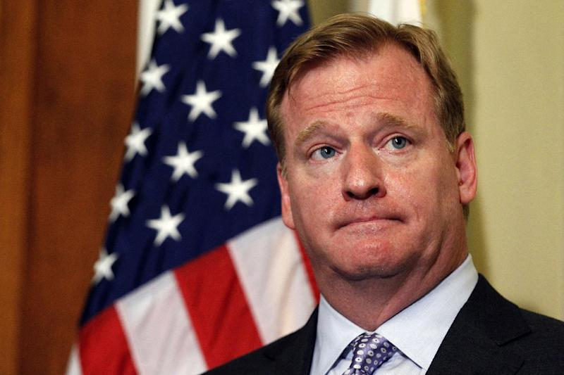 """FILE - In this file photo made June 20, 2012, NFL Commissioner Roger Goodell stands during a media availability to discuss bounty programs on Capitol Hill in Washington. The NFL Players Association filed a lawsuit against the NFL on behalf of three players suspended in connection with the bounty investigation, calling Goodell """"incurably and evidently biased."""" The lawsuit, filed in federal court in New Orleans on Thursday, July 5, 2012, said Goodell violated the labor agreement by showing he had determined Will Smith, Anthony Hargrove and Scott Fujita participated in a bounty system before serving as an arbitrator at their hearing. (AP Photo/Alex Brandon, file)"""