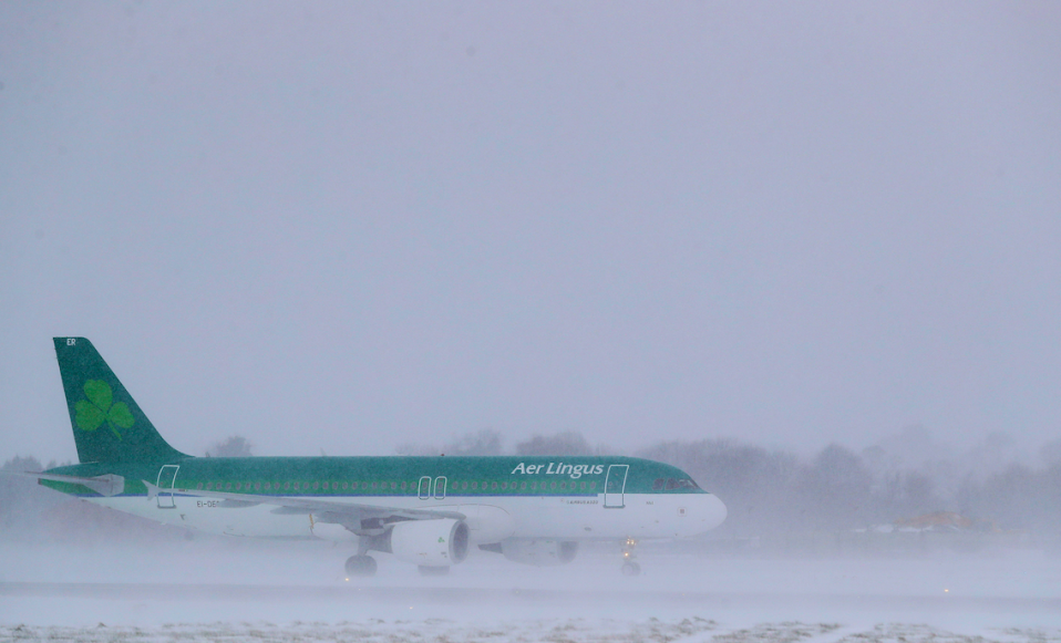 <em>An Aer Lingus plane after landing at Dublin airport, as heavy snow has caused more misery for travellers overnight (PA)</em>