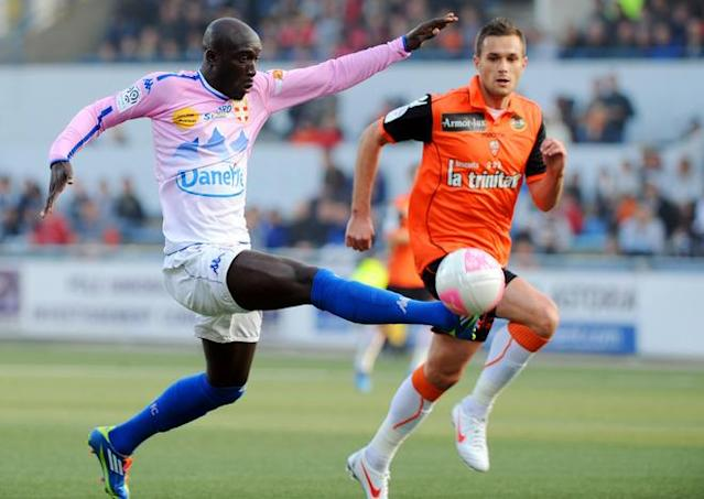 Lorient's French defender Gregory Bourillon (R) vies with Evian-Thonon Gaillard's French forward Yannick Anister Sagbo-Latte during the French L1 football match Lorient vs. Evian-Thonon Gaillard at the Moustoir stadium on March 31, 2012 in Lorient, western of France. AFP PHOTO / FRED TANNEAU