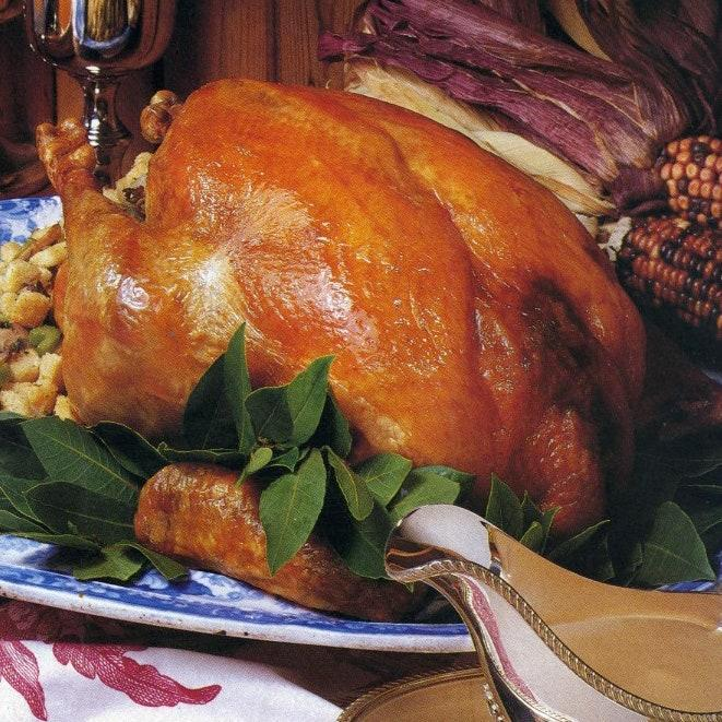 """This recipe comes from the November 1988 issue and is part of our Thanksgiving Hall of Fame series. This large turkey will serve 16. If you have a smaller group, there will be plenty of leftovers to enjoy over the next few days. <a href=""""https://www.bonappetit.com/recipe/roast-turkey-with-sausage-and-apple-stuffing-and-pan-gravy?mbid=synd_yahoo_rss"""" rel=""""nofollow noopener"""" target=""""_blank"""" data-ylk=""""slk:See recipe."""" class=""""link rapid-noclick-resp"""">See recipe.</a>"""