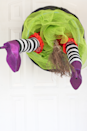 """<p>Here's a clever way to make your trick-or-treaters smile: Build a realistic-looking """"witch crash"""" right into your door.</p><p><strong>Get the tutorial at <a href=""""https://thealisonshow.com/"""" rel=""""nofollow noopener"""" target=""""_blank"""" data-ylk=""""slk:The Alison Show"""" class=""""link rapid-noclick-resp"""">The Alison Show</a>.</strong></p><p><strong><a class=""""link rapid-noclick-resp"""" href=""""https://go.redirectingat.com?id=74968X1596630&url=https%3A%2F%2Fwww.walmart.com%2Fip%2F41-INCH-STRAW-WITCH-BROOM%2F441388102&sref=https%3A%2F%2Fwww.thepioneerwoman.com%2Fholidays-celebrations%2Fg32894423%2Foutdoor-halloween-decorations%2F"""" rel=""""nofollow noopener"""" target=""""_blank"""" data-ylk=""""slk:SHOP BROOMS"""">SHOP BROOMS</a><br></strong></p>"""