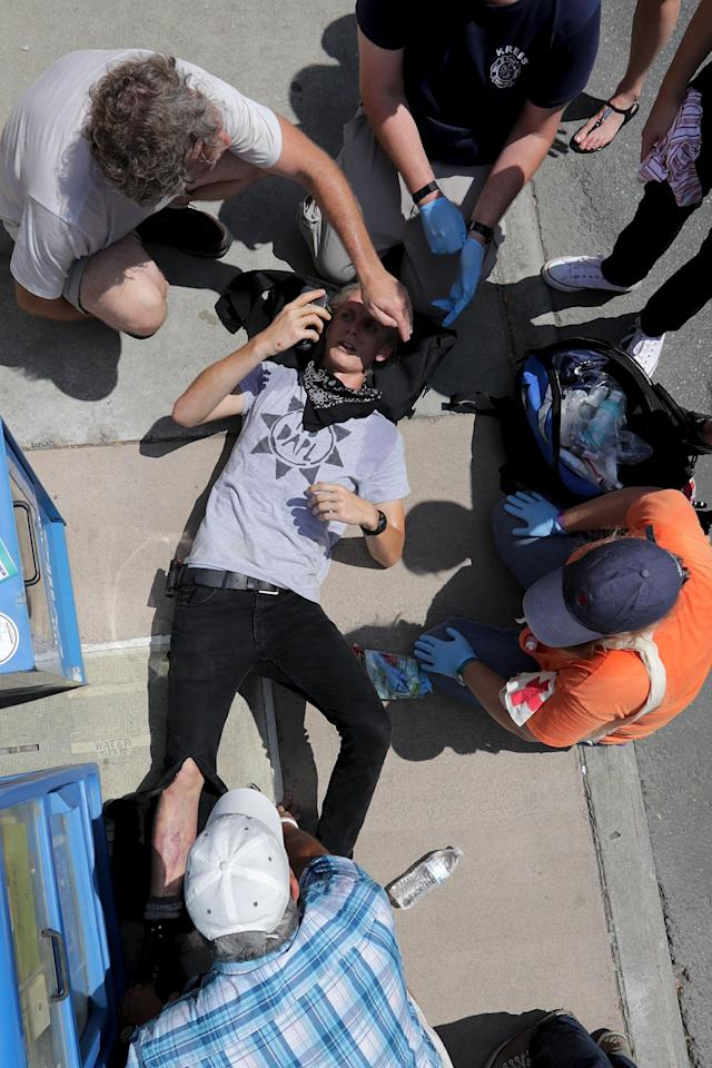 <p>CHARescue workers and medics tend to many people who were injured when a car plowed through a crowd of anti-facist counter-demonstrators marching through the downtown shopping district Aug. 12, 2017 in Charlottesville, Va. (Photo: Chip Somodevilla/Getty Images) </p>
