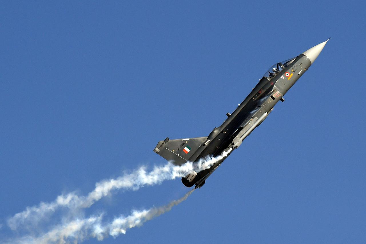 An Indian Air Force (IAF) Light Combat Aircraft Tejas flies past during the Air Force Day parade at an IAF station in Ghaziabad, on the outskirts of New Delhi, on October 8, 2019. - The Indian Air Force is celebrating its 87th anniversary. (Photo by Prakash SINGH / AFP) (Photo by PRAKASH SINGH/AFP via Getty Images)