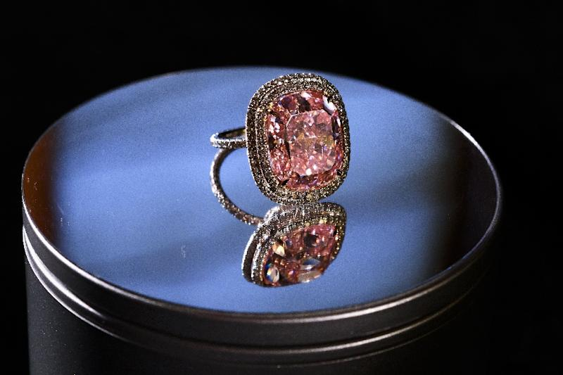 "Property tycoon Joseph Lau spent $28.5 million buying a rare 16.08-carat pink diamond, the largest of its kind to ever go under the hammer, from Christie's, which he rebaptised ""Sweet Josephine"" (AFP Photo/Fabrice Coffrini)"
