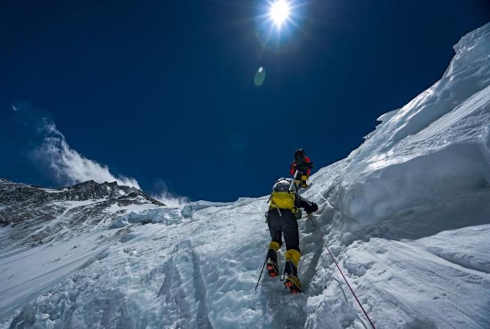 """<div class=""""inline-image__caption""""> <p>Team members climb Mt. Everest during an expedition to find Sandy Irvine's remains. </p> </div> <div class=""""inline-image__credit""""> National Geographic/Renan Ozturk </div>"""