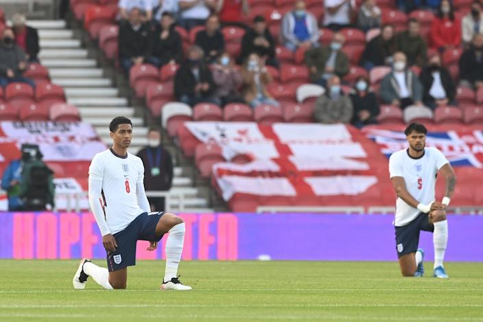 England's Jude Bellingham and Tyrone Mings taking the knee (The FA via Getty Images)