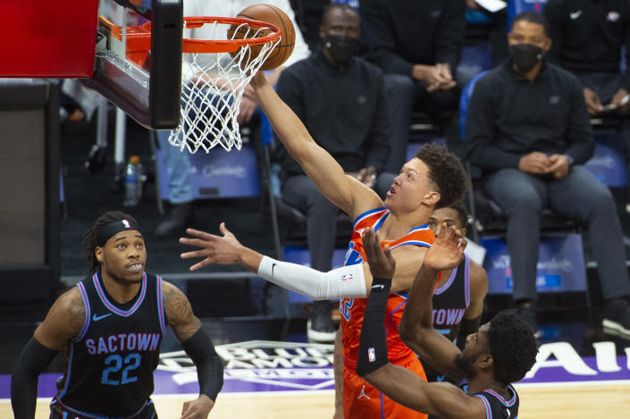 Oklahoma City Thunder center Isaiah Roby (22) drives to the basket against the Sacramento Kings during the first quarter of an NBA basketball game in Sacramento, Calif., Tuesday, May 11, 2021. (AP Photo/Randall Benton)