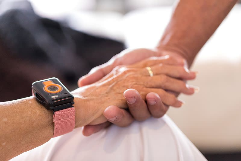 A photo illustration provided by CarePredict shows an individual wearing the company's Tempo wearable wristband