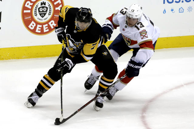 Pittsburgh Penguins' Matt Cullen (7) skates in his 1,500th NHL hockey game against Florida Panthers' Mark Pysyk (13) during the first period in Pittsburgh, Tuesday, March 5, 2019. (AP Photo/Gene J. Puskar)