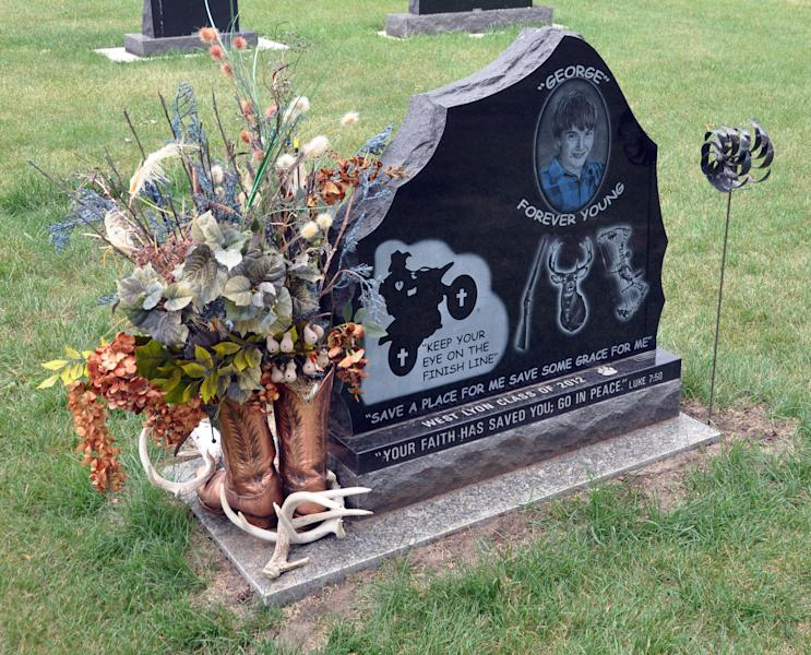 The back of a gravestone for Jordan Monen, who was killed last year in a farm accident, depicts his love of dirt bikes and hunting, Wednesday, June 20, 2012, in a cemetery in Lester, Iowa. (AP Photo/Dirk Lammers)