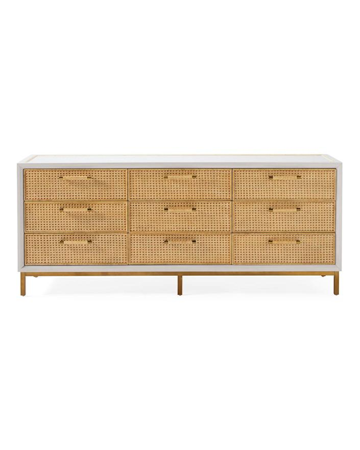 """When it comes to coastal-chic pieces, Serena & Lily is our go-to. Complete with handwoven <a href=""""https://www.architecturaldigest.com/story/were-seeing-cane-furniture-everywhere-again?mbid=synd_yahoo_rss"""" rel=""""nofollow noopener"""" target=""""_blank"""" data-ylk=""""slk:caning"""" class=""""link rapid-noclick-resp"""">caning</a>, a salt-washed finish, and barely there brass accents, this sizable dresser is a unique nod to island living in all the right ways. $4298, Serena & Lily. <a href=""""https://www.serenaandlily.com/bar-island-dresser/natural/m13177.html?"""" rel=""""nofollow noopener"""" target=""""_blank"""" data-ylk=""""slk:Get it now!"""" class=""""link rapid-noclick-resp"""">Get it now!</a>"""