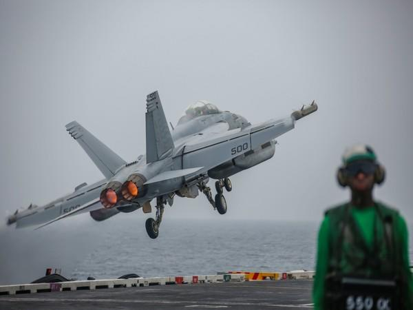 An EA-18G Growler attached to the