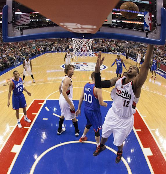 Portland Trail Blazers' LaMarcus Aldridge, right, shoots as he gets past Philadelphia 76ers' Spencer Hawes during the first half of an NBA basketball game on Saturday, Dec. 14, 2013, in Philadelphia. (AP Photo/Chris Szagola)