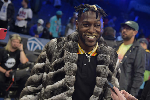 NFL player, Antonio Brown smiles and laughs during the 2019 NBA All-Star Game on February 17, 2019 at Spectrum Center in Charlotte, North Carolina. (Photo by Tom O'Connor/NBAE via Getty Images)