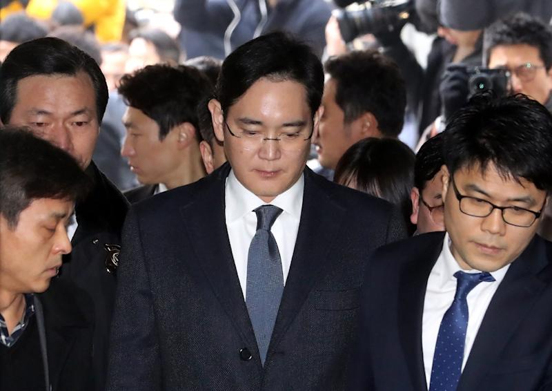 Lee Jae-Yong (C), Samsung Electronics vice chairman and the son of Samsung group chairman Lee Kun-Hee, arrives at the court for a hearing to review the issuing of his arrest warrant at the Seoul Central District Court in Seoul on February 16, 2017