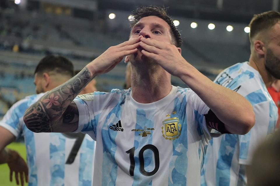 Argentina's Lionel Messi blows a kiss to fans as he celebrates after winning the Conmebol 2021 Copa America football tournament final match against Brazil at Maracana Stadium in Rio de Janeiro, Brazil, on July 10, 2021. - Argentina won 1-0. (Photo by CARL DE SOUZA / AFP) (Photo by CARL DE SOUZA/AFP via Getty Images)