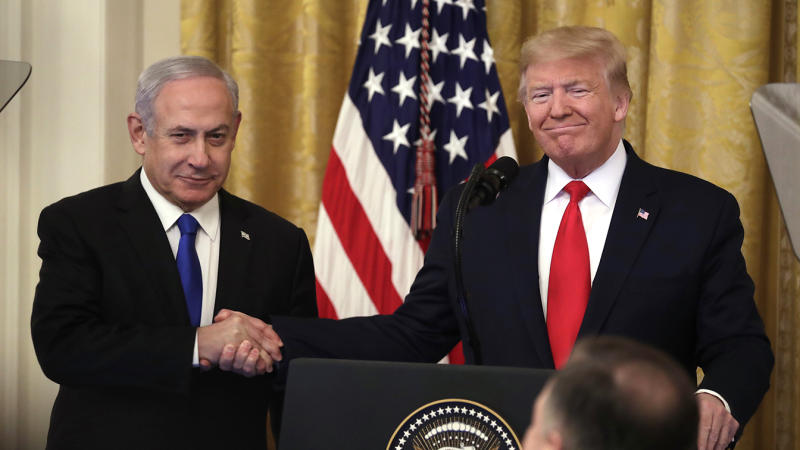 President Trump shakes hands with Israeli Prime Minister Benjamin Netanyahu in the East Room of the White House on Tuesday. (Andrew Harrer/Bloomberg via Getty Images)