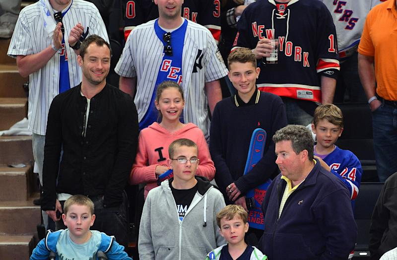Jude Law, Iris Law, Finlay Law and Rudy Law attend the Ottawa Senators vs New York Rangers game at Madison Square Garden on April 14, 2012 in New York City. (Photo by James Devaney/FilmMagic)