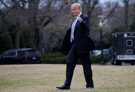 U.S. President Trump walks to Marine One to depart for travel to Florida from the White House