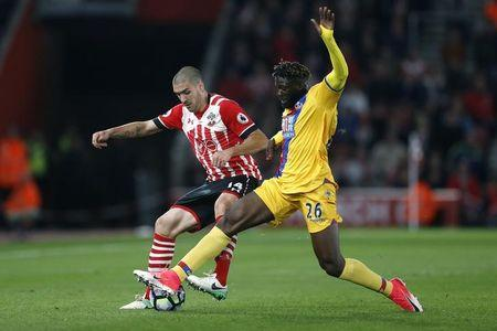 Southampton's Oriol Romeu in action with Crystal Palace's Bakary Sako