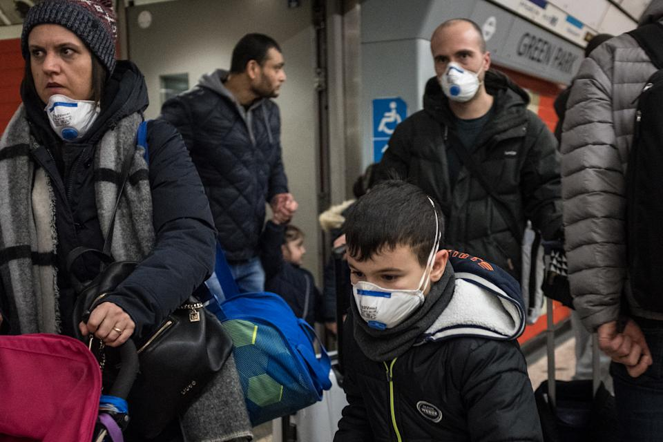 People are seen on a tube wearing face masks. A total of nine people in the UK are now being treated for COVID-19, the disease caused by the coronavirus. Doctors have warned that the London Underground could be a hotbed for the coronavirus. (Photo by S.C. Leung / SOPA Images/Sipa USA)