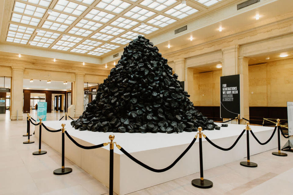 A pile of roughly 2,400 black hats on display at Union Station.