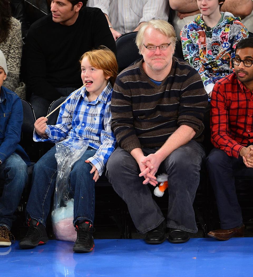 NEW YORK, NY - NOVEMBER 25:  Philip Seymour Hoffman and son Cooper Alexander Hoffman (L) attend the Detroit Pistons vs New York Knicks game at Madison Square Garden on November 25, 2012 in New York City.  (Photo by James Devaney/WireImage)