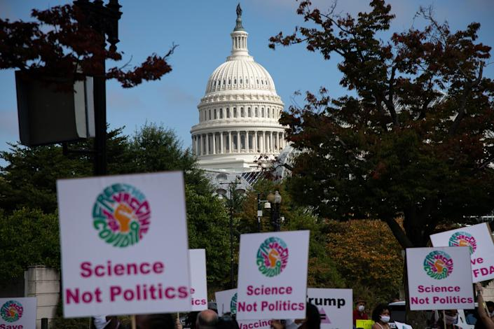 A view of the U.S. Capitol Building as demonstrators march to the Department of Health and Human Services (HHS) headquarters during a protest organized by groups calling for safe vaccines on Oct. 21