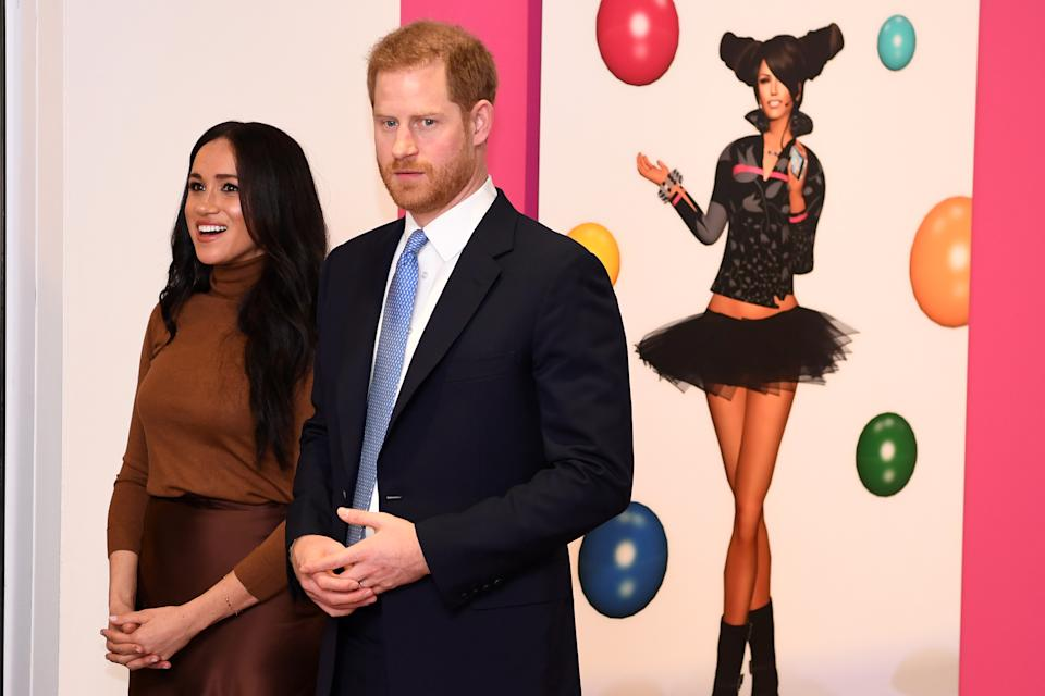 Britain's Prince Harry, Duke of Sussex and Meghan, Duchess of Sussex react as they view a special exhibition of art by Indigenous Canadian artist, Skawennati, in the Canada Gallery during their visit to Canada House, in London on January 7, 2020, to give thanks for the warm Canadian hospitality and support they received during their recent stay in Canada. (Photo by DANIEL LEAL-OLIVAS / various sources / AFP) (Photo by DANIEL LEAL-OLIVAS/AFP via Getty Images)