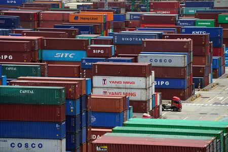Shipping containers are seen at a port in Shanghai