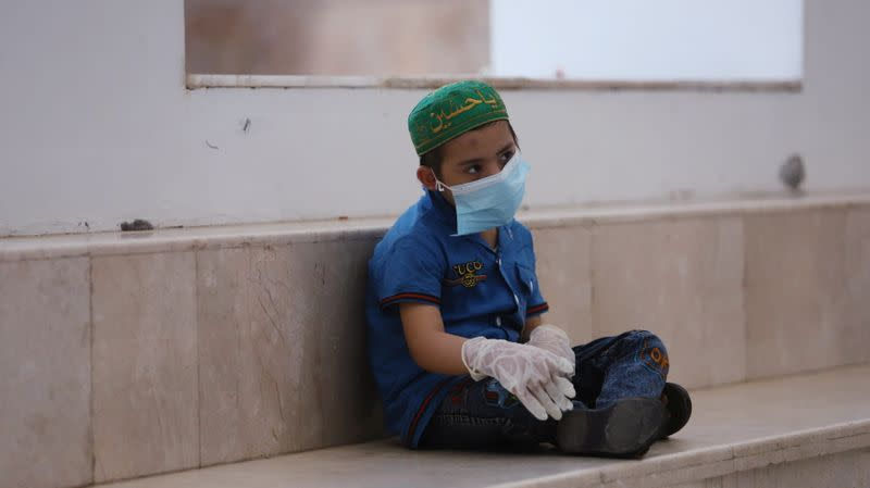 A child who suffers from cancer sits in a corridor at the Children's Hospital for Cancer Diseases in Basra