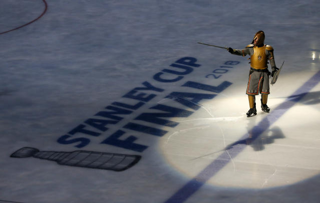 An actor dressed as a knight performs during a show prior to Game 2 of the NHL hockey Stanley Cup Finals between the Vegas Golden Knights and the Washington Capitals on Wednesday, May 30, 2018, in Las Vegas. (AP Photo/Ross D. Franklin)