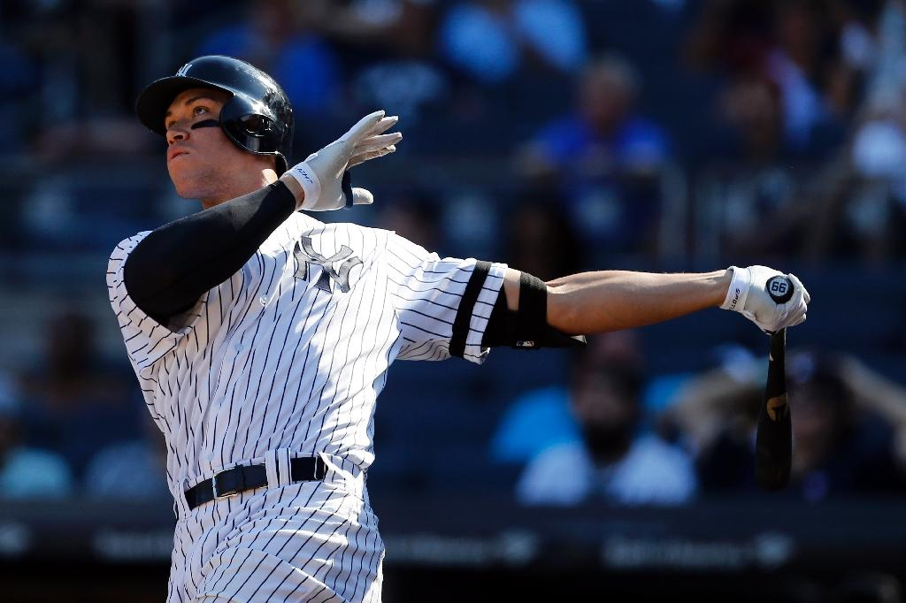 Aaron Judge of the New York Yankees hits a solo home run against the Kansas City Royals during the seventh inning at Yankee Stadium on September 25, 2017 in the Bronx borough of New York City (AFP Photo/Adam Hunger)