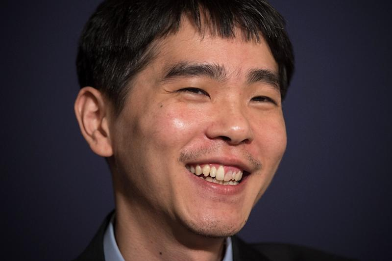 Go player Lee Se-Dol smiles during a post-match press conference after his first win against a Google-developed super-computer in Seoul on March 13, 2016 (AFP Photo/Ed Jones)