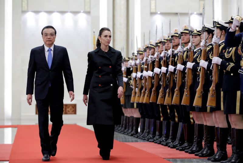 FILE PHOTO: Jacinda Ardern and China's Premier Li Keqiang attend a welcome ceremony in Beijing