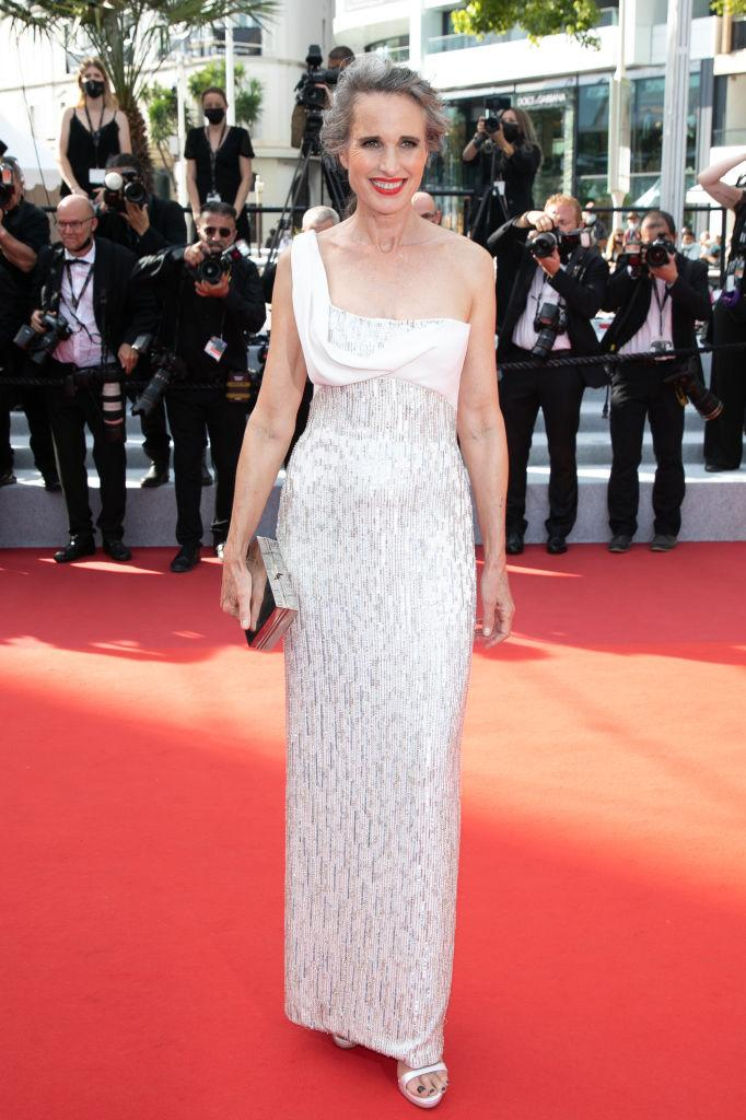 Andie McDowell has embraced her natural grey hair, pictured in Cannes, July, 2021. (Getty Images)