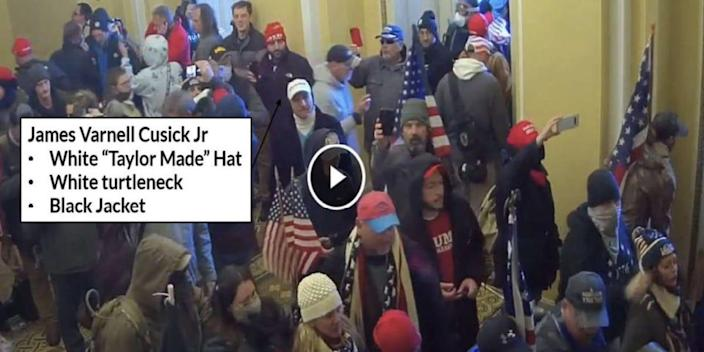 Protesters congregate inside the Capitol during the January 6 insurrection.