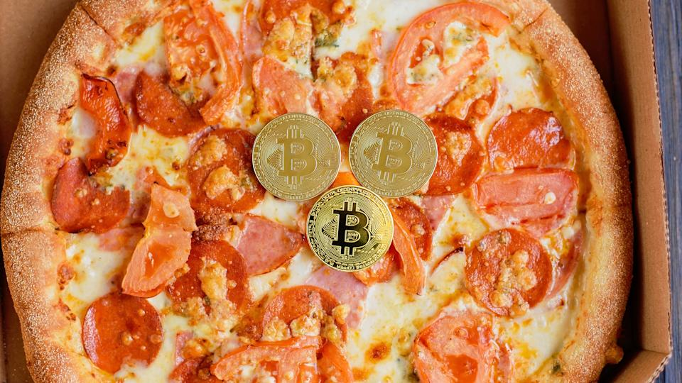 Kyiv, Ukraine  May 05, 2020. Golden bitcoin coins. Bitcoin Pizza Day 22 May. crypto community holiday. 2 pizzas for a price of 10000 Bitcoins. Pizza Index