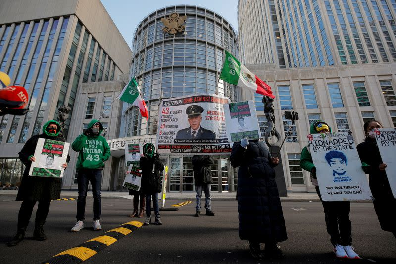 FILE PHOTO: People protest outside the Brooklyn Federal Courthouse over the decision to drop drug charges against Mexico's former defense Minister General Salvador Cienfuegos, in Brooklyn, New York