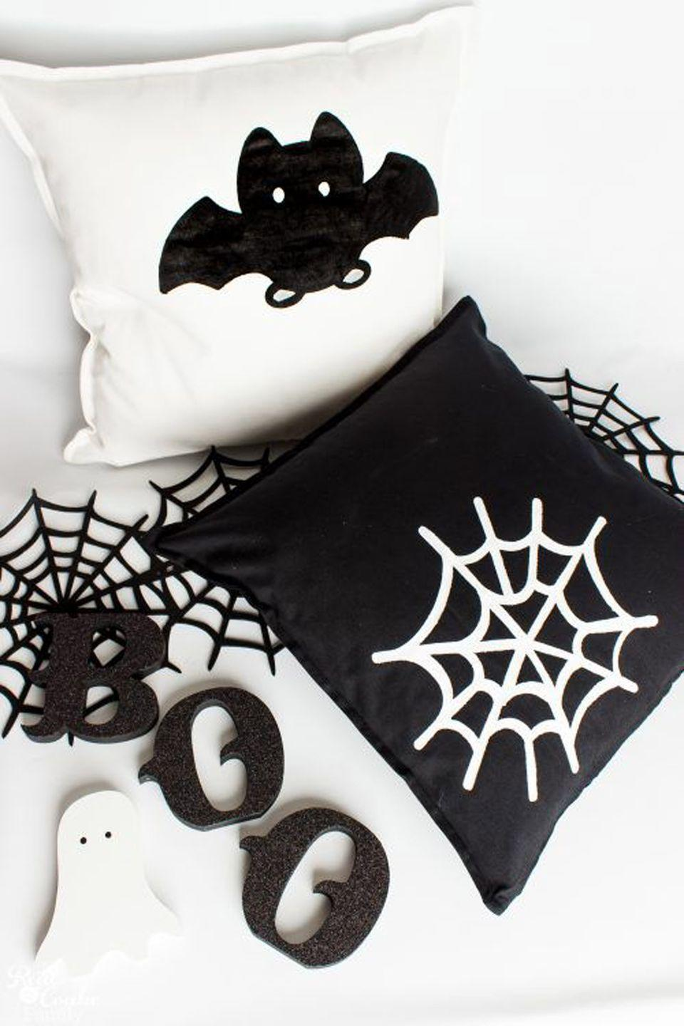 "<p>Decorate your home with easy <a href=""https://www.countryliving.com/diy-crafts/g1189/best-halloween-crafts-ever/"" rel=""nofollow noopener"" target=""_blank"" data-ylk=""slk:DIY Halloween projects"" class=""link rapid-noclick-resp"">DIY Halloween projects</a>, like these graphic black-and-white pillows.</p><p><strong>Get the tutorial at <a href=""https://www.realcoake.com/halloween-decorative-pillows/"" rel=""nofollow noopener"" target=""_blank"" data-ylk=""slk:Real Creative Real Organized"" class=""link rapid-noclick-resp"">Real Creative Real Organized</a>.</strong></p><p><a class=""link rapid-noclick-resp"" href=""https://www.amazon.com/beddingstar-European-Pillows-Pillowcase-Egyptian/dp/B07DXQTFNX/?tag=syn-yahoo-20&ascsubtag=%5Bartid%7C2139.g.34440360%5Bsrc%7Cyahoo-us"" rel=""nofollow noopener"" target=""_blank"" data-ylk=""slk:SHOP PILLOWS"">SHOP PILLOWS</a></p>"