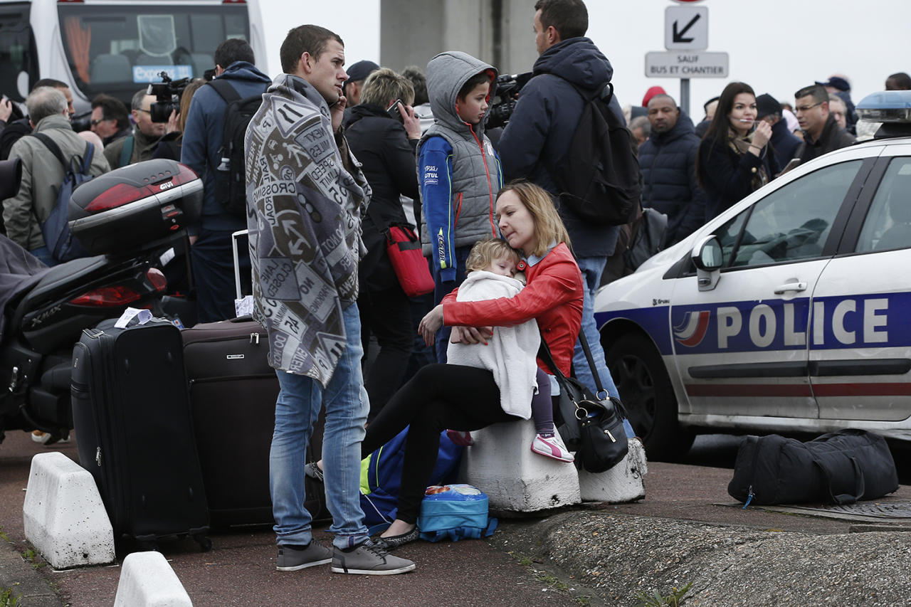 <p>Travelers wait outside the Orly airport, south of Paris, Saturday, March, 18, 2017. A man was shot to death after trying to seize the weapon of a soldier guarding Paris' Orly Airport, prompting a partial evacuation of the terminal, police said. Authorities warned visitors to avoid the area while an ongoing police operation was underway. (AP Photo/Thibault Camus) </p>