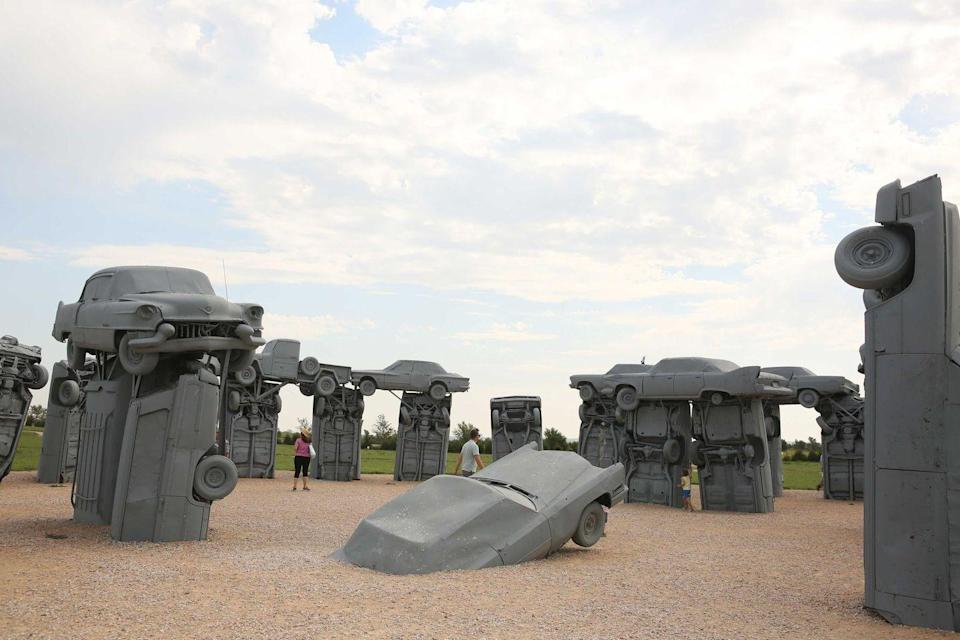 """<p><strong>Carhenge</strong></p><p>The <a href=""""https://www.roadsideamerica.com/story/2606"""" rel=""""nofollow noopener"""" target=""""_blank"""" data-ylk=""""slk:Carhenge"""" class=""""link rapid-noclick-resp"""">Carhenge</a> is definitely a quirky and """"where else would I see this"""" attraction. Spoofing the Stonehenge in England, the Carhenge, located north of Alliance, Nebraska on Highway 87 is made out of automobiles. Replicating the original stone version, 39 cars make up this masterpiece.</p>"""