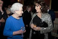 <p>Joan Collins isn't the muted-outfit type—and the silver metallic jacket she wore for this occasion is proof. She <em>almost</em> upstaged the Queen.</p>