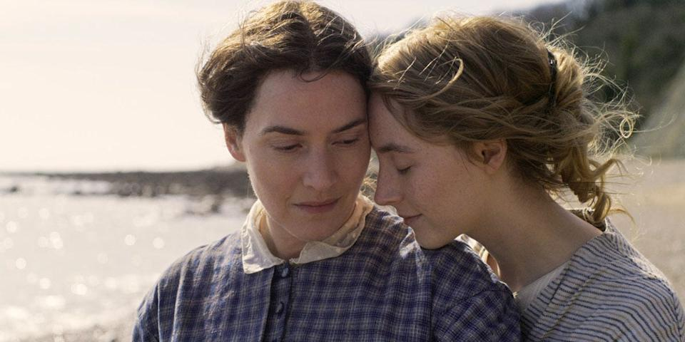 A paleontologist (Kate Winslet, left) and a wealthy young wife (Saoirse Ronan) fall in love in the romance