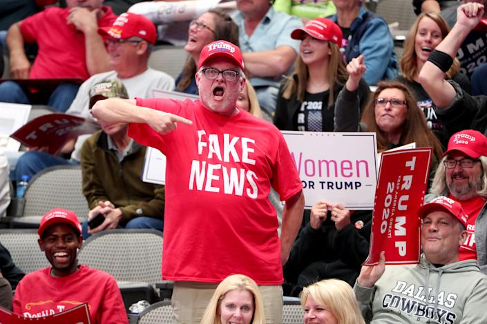 Supporters react as U.S. President Donald Trump speaks during a