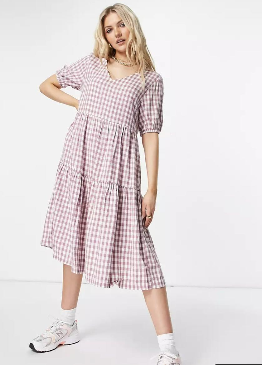 <p>Whether you're catching up with friends at a coffee shop or exploring a new neighborhood on your own, this <span>JDY Gingham Tiered Midi Dress</span> ($42) has you covered with style and comfort.</p>