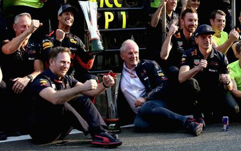<span>The Red Bull team celebrate on hearing that Daniel Ricciardo tops our driver rankings. </span> <span>Credit: GETTY IMAGES </span>