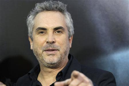 "Producer Alfonso Cuaron arrives for the film premiere of ""Gravity"" in New York in this October 1, 2013 file photograph. REUTERS/Andrew Kelly/Files"