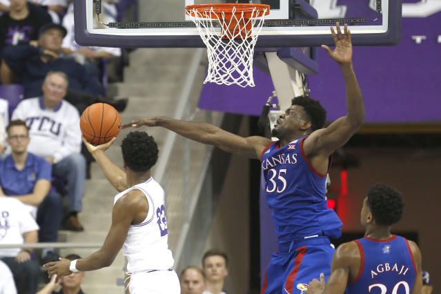 TCU guard RJ Nembhard (22) scores on a reverse layup against Kansas center Udoka Azubuike (35) during the second half of an NCAA college basketball game, Saturday, Feb. 8, 2020 in Fort Worth, Texas. Kansas won 60-46. (AP Photo/Ron Jenkins)